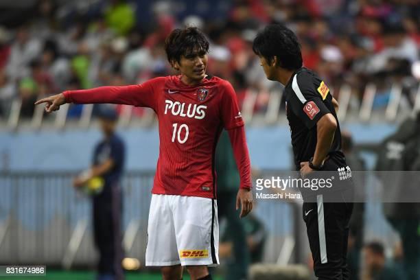 Yosuke Kashiwagi of Urawa Red Diamonds talks to head coach Takafumi Hori during the Suruga Bank Championship match between Urawa Red Diamonds and...