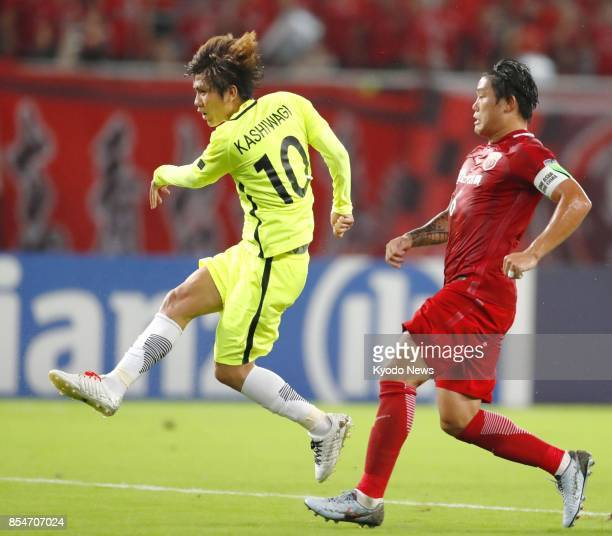 Yosuke Kashiwagi of Urawa Reds scores the equalizer in the first leg of their Asian Champions League semifinal tie against Shanghai SIPG in Shanghai...
