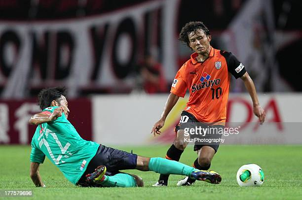 Yosuke Kawai of Shimizu SPulse is tackled by Yuki Abe of Urawa Red Diamonds during the JLeague match between Shimizu SPulse and Urawa Red Diamonds at...