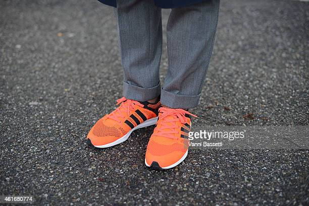 Yosuke Konno poses wearing Pt01 pants and Adidas shoes on January 17 2015 in Milan Italy