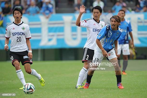 Yosuke Nozaki of Yokohama FC and Hayuma Tanaka of Matsumoto Yamaga compete for the ball during the JLeague second division match between Yokohama FC...