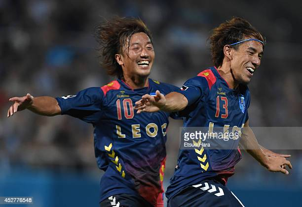 Yosuke Nozaki of Yokohama FC celebrates scoring his team's second goal with his teammate Shinichi Terada during the J League second division match...