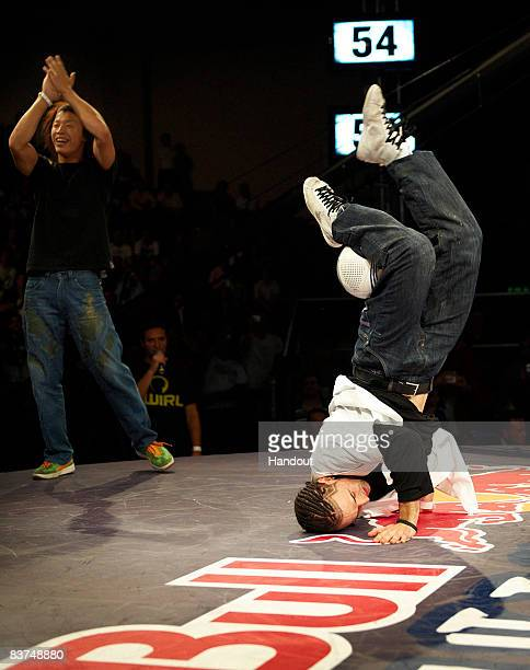 Yosuke Yokota of Japan applauds as Arnaud Garnier of France performs during the final oneonone battle in the Red Bull Street Style World Finals at...