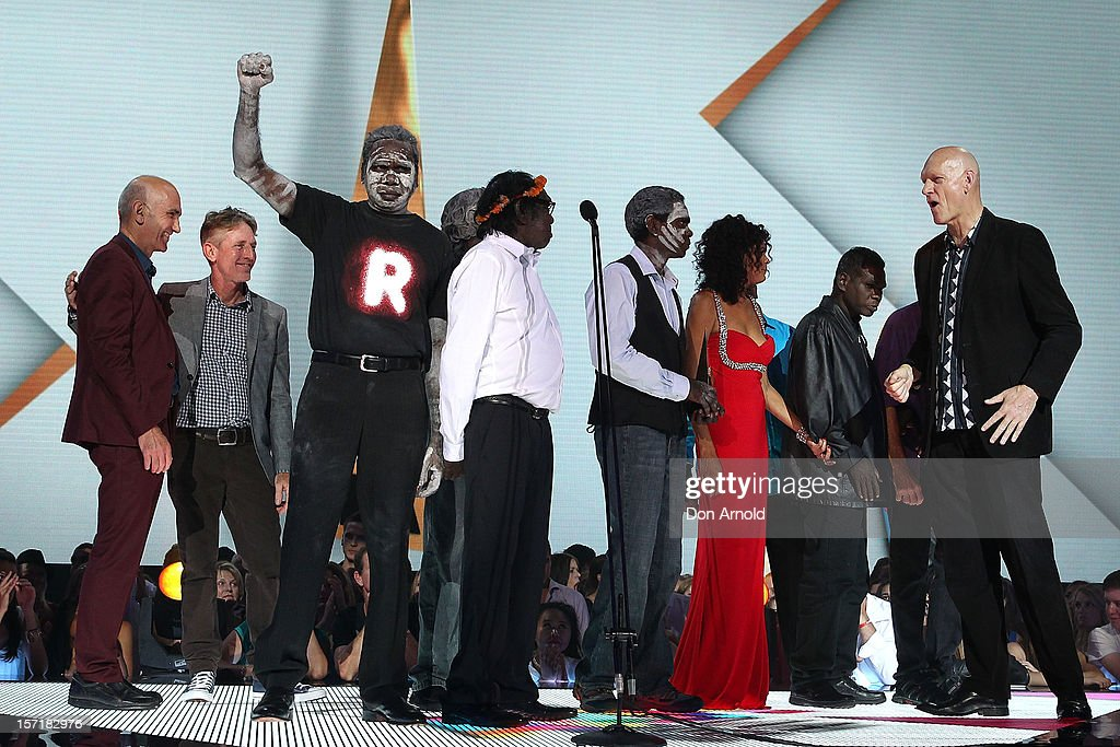 Yothu Yindi accept their induction into the ARIA Hall of Fame with Paul Kelly and <a gi-track='captionPersonalityLinkClicked' href=/galleries/search?phrase=Peter+Garrett&family=editorial&specificpeople=213494 ng-click='$event.stopPropagation()'>Peter Garrett</a> on stage during the 26th Annual ARIA Awards 2012 at the Sydney Entertainment Centre on November 29, 2012 in Sydney, Australia.
