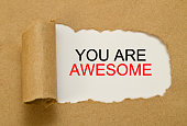 You are awesome message written under torn paper