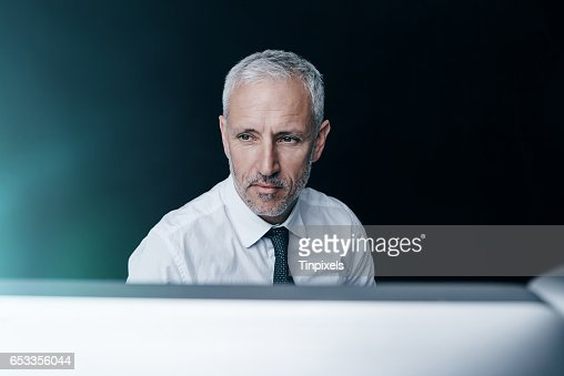 You can always find him behind his monitor : ストックフォト