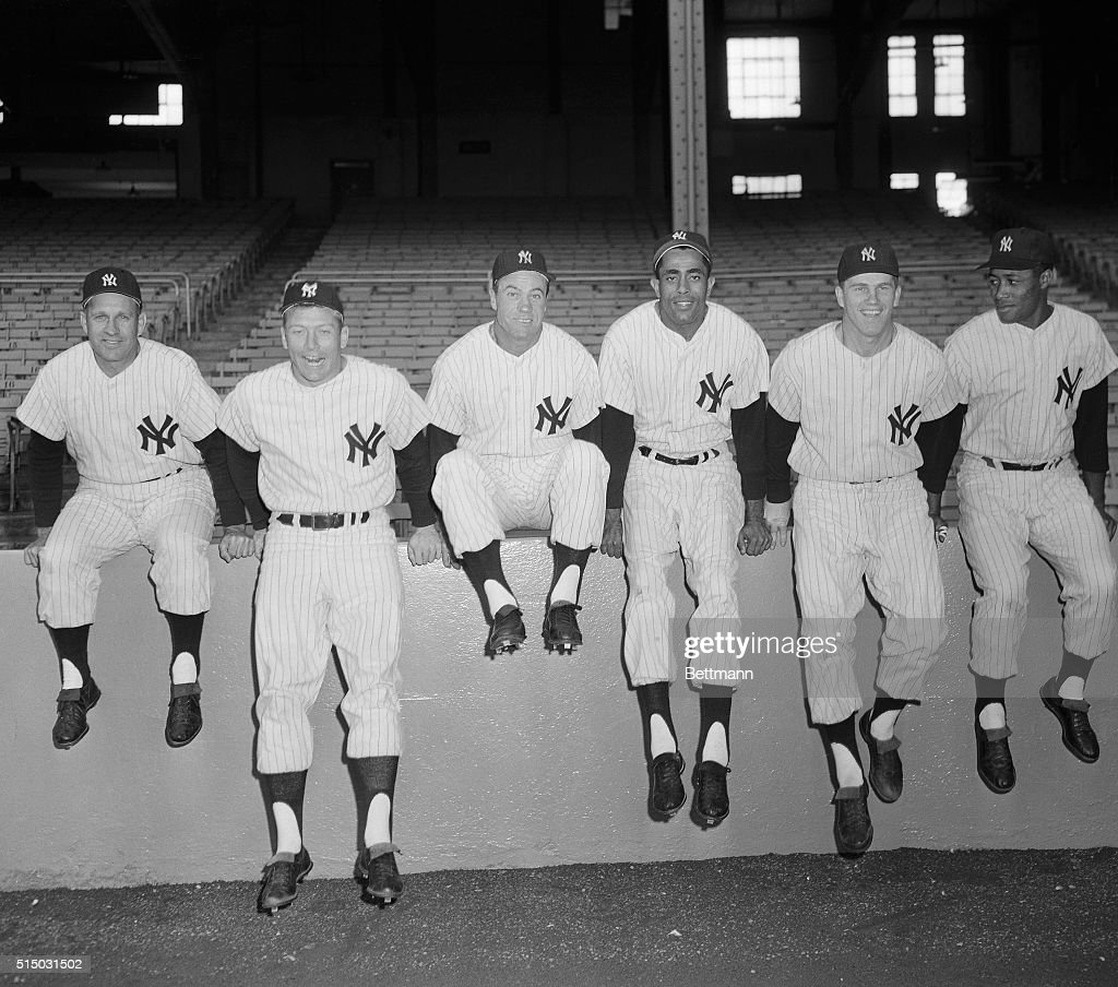 You can't blame these Yankees if they see waving in the breeze of Yankee Stadium, one 1957 American League pennant. Their team is six and one-half games in the lead as of now. Outfielders, left to right, are Enos Slaughter, Mickey Mantle, Hank Bauer, Harry Simpson, Tony Kubek and Elston Howard line up.
