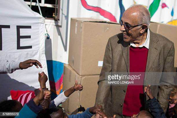 You children give thumbs up to South African politician former political prisoner and antiapartheid activist Ahmed Kathrada as he takes part in a...