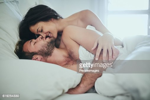 sexy couple laying in bed stock photos and pictures getty images. Black Bedroom Furniture Sets. Home Design Ideas