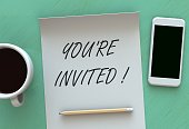You re Invited, message on paper, smart phone and coffee on table, 3D rendering
