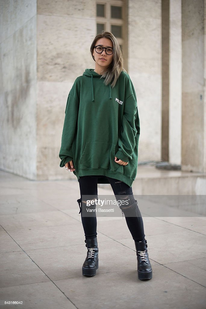 You Shin poses wearing a Vetements sweatshirt after the Lanvin show at the Palais de Tokyo during Paris Fashion Week Menswear SS17 on June 26, 2016 in Paris, France.