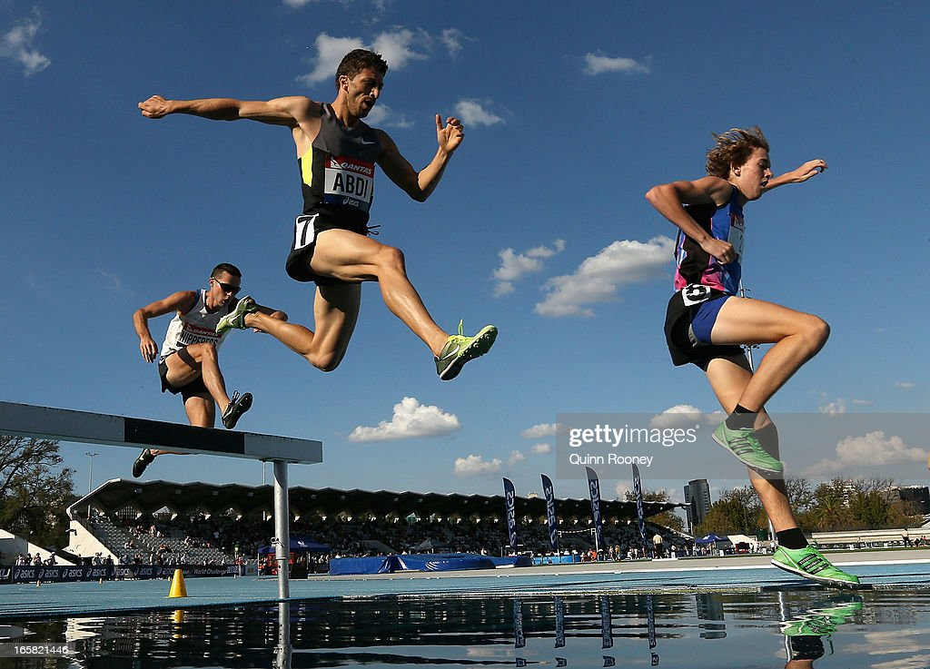 Youcef Abdi and James Nipperess of Australia compete in the Men's 3000 Metres Steeplechase during the 2013 Melbourne Track Classic at Olympic Park on April 6, 2013 in Melbourne, Australia.