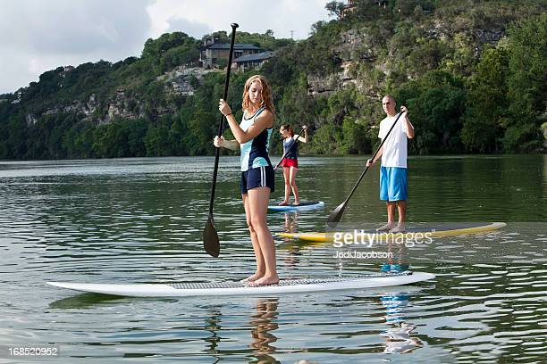 Youg adults paddleboarding stand up paddling