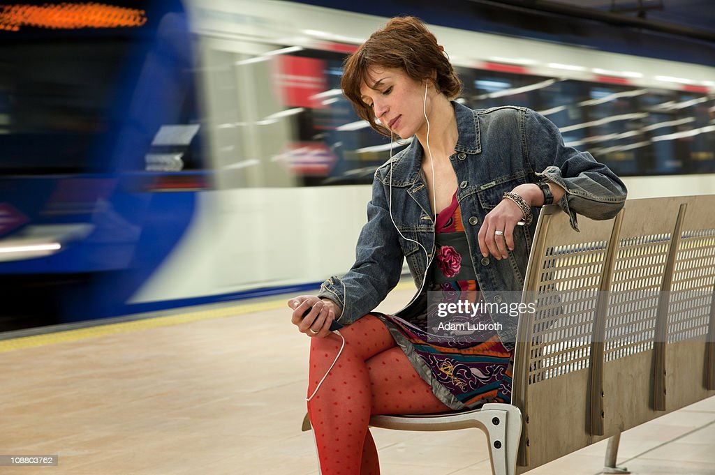 Youg woman awaits subway : Stock Photo