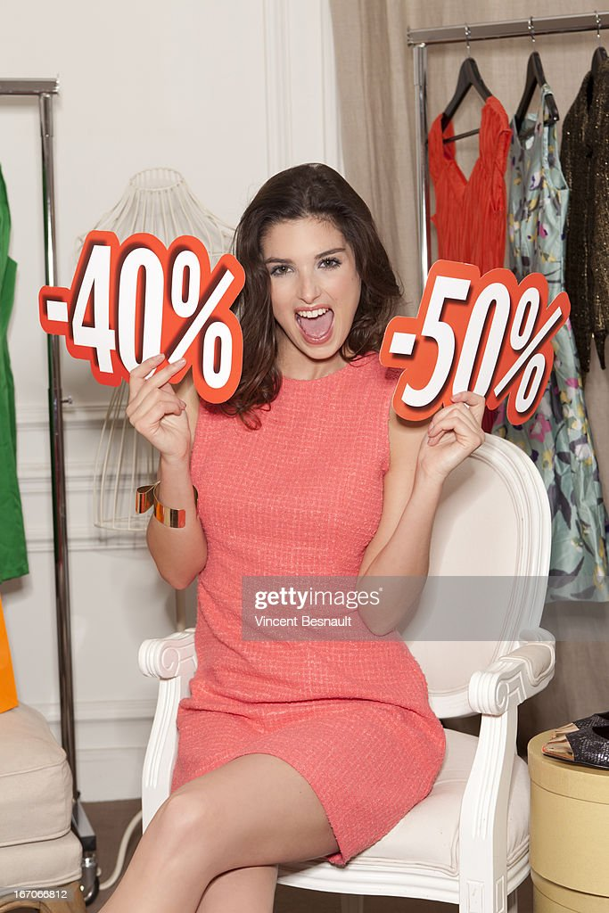 Youg woman in a clothing store : Stock Photo