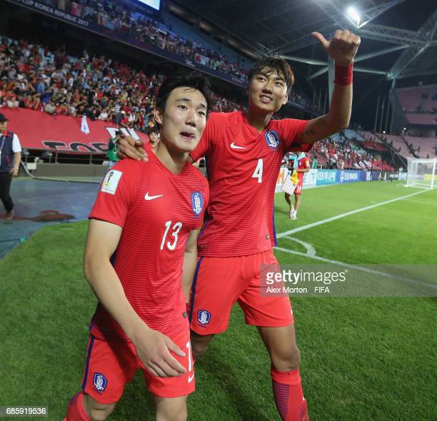 Youhyeon Lee and Taewook Jeong of Korea celebrate at the end of the match during the FIFA U20 World Cup Korea Republic 2017 group A match between...
