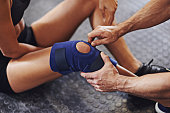 Shot of a sportswoman being helped with a knee injuryhttp://195.154.178.81/DATA/i_collage/pi/shoots/806023.jpg