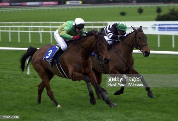 Youlneverwalkalone ridden by Barry Geraghty overtakes Foxchapel King ridden by David Casey to win the Pierse Leopardstown Handicap Steeplechase at...