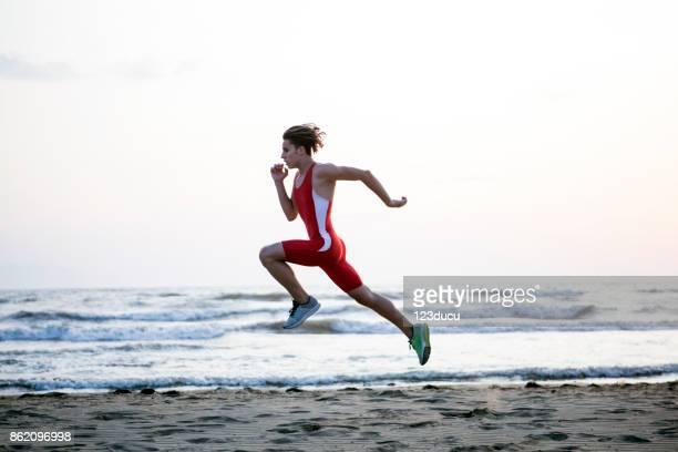 Youn Man Running At Beach