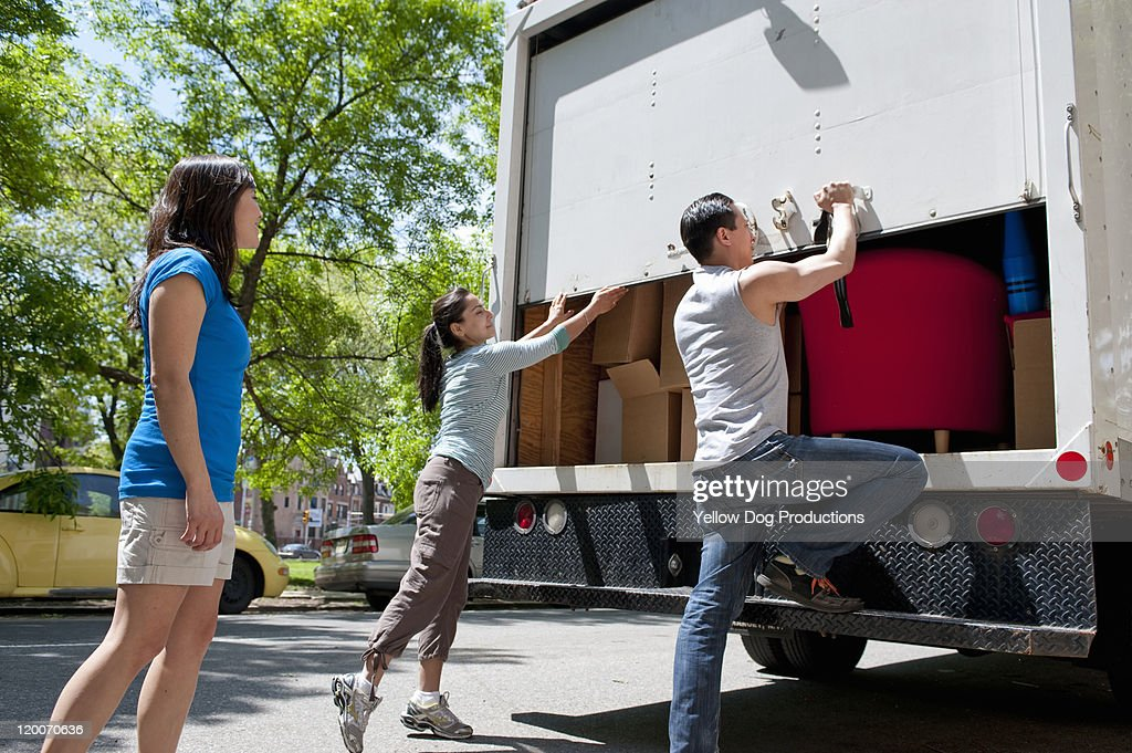 Yound Adults opening back of moving truck