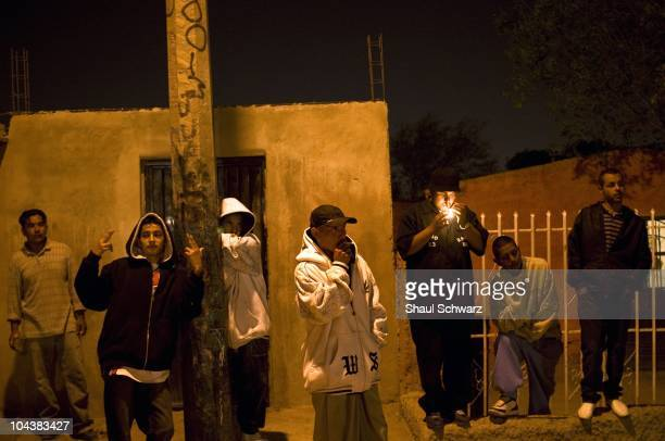 Yound gang members called 'Baja 13' hang out in a street corner in the city of Juarez The violence generated by the war of the drug cartels for...