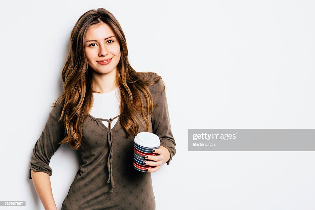 Yound girl having a coffee : Stock Photo