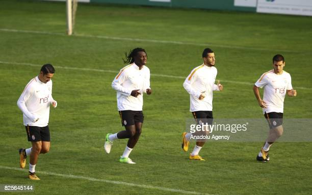 Younes Belhanda and Bafetimbi Gomis of Galatasaray attend a training session as part of the Turkish Spor Toto Super Lig new season preparations in...