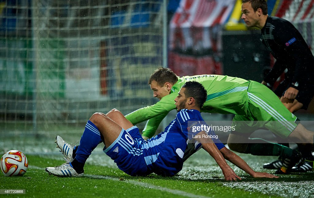 Younes Belhanda of Dynamo Kyiv and Goalkeeper Nicolai Larsen of AaB Aalborg compete for the ball during the UEFA Europa League match between AaB Aalborg and Dynamo Kyiv at Nordjyske Arena on October 23, 2014 in Aalborg, Denmark.