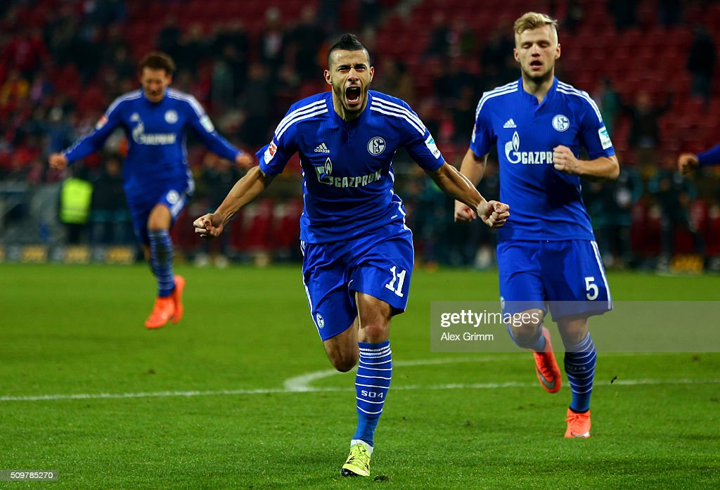 Younes Belhanda of FC Schalke 04 celebrates after scoring his team's first goal during the Bundesliga match between 1. FSV Mainz 05 and FC Schalke 04 at Coface Arena on February 12, 2016 in Mainz, Germany.