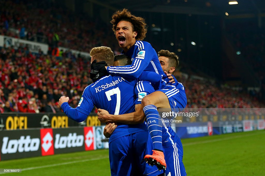 Younes Belhanda of FC Schalke 04 celebrates with team-mates Maximilian Meyer and Leroy Sane after scoring his team's first goal during the Bundesliga match between 1. FSV Mainz 05 and FC Schalke 04 at Coface Arena on February 12, 2016 in Mainz, Germany.