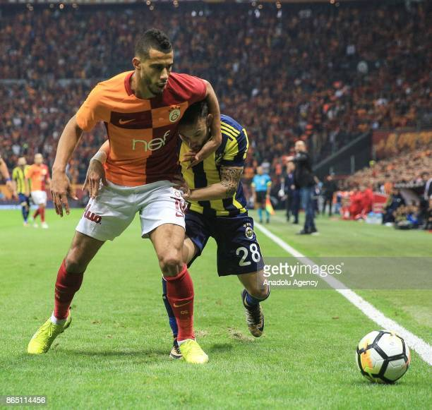 Younes Belhanda of Galatasaray in action against Mathieu Valbuena of Fenerbahce during the Turkish Super Lig match between Galatasaray and Fenerbahce...