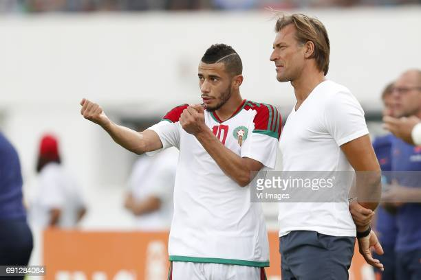 Younes Belhanda of Morocco coach Herve Renard of Moroccoduring the friendly match between Morocco and The Netherlands at Grand Stade Adrar on May 31...