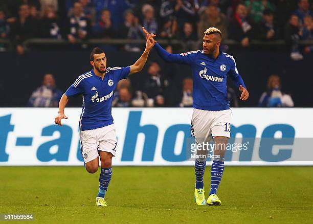 Younes Belhanda of Schalke celebrates with team mate Maxim ChoupoMoting as he scores their first goal during the Bundesliga match between FC Schalke...