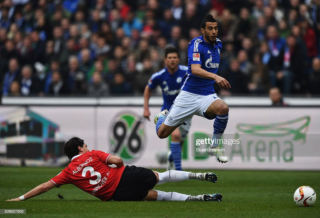 Younes Belhanda of Schalke is challenged by <a gi-track='captionPersonalityLinkClicked' href=/galleries/search?phrase=Miiko+Albornoz&family=editorial&specificpeople=8240937 ng-click='$event.stopPropagation()'>Miiko Albornoz</a> of Hannover during the Bundesliga match between Hannover 96 and FC Schalke 04 at the HDI Arena on April 30, 2016 in Hanover, Lower Saxony.