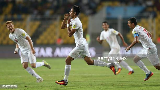 Younes Delfi of Iran celebrates scoring the opening goal during the FIFA U17 World Cup India 2017 group C match between Iran and Germany at Pandit...