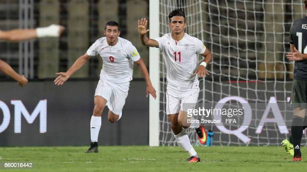 Younes Delfi of Iran celebrates with team mate Allahyar Sayyad of Iran after scoring his team's first goal during the FIFA U17 World Cup India 2017...