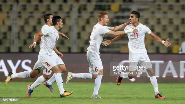 Younes Delfi of Iran celebrates with team mates after scoring his team's first goal during the FIFA U17 World Cup India 2017 group C match between...
