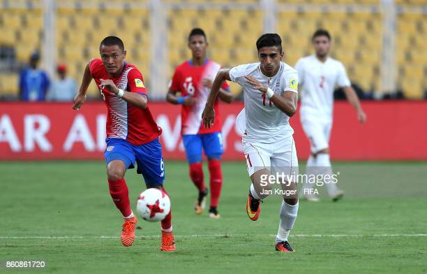 Younes Delfi of Iran competes for the ball with Walter Cortes of Costa Rica during the FIFA U17 World Cup India 2017 group C match between Costa Rica...