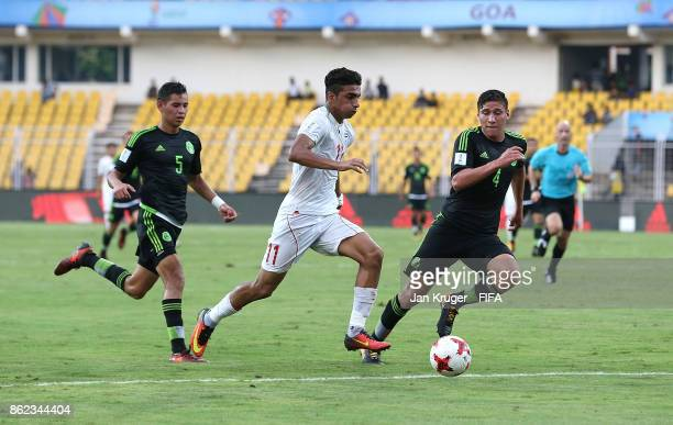 Younes Delfi of Iran controls the ball from Luis Olivas of Mexico during the FIFA U17 World Cup India 2017 Round of 16 match between Iran and Mexico...