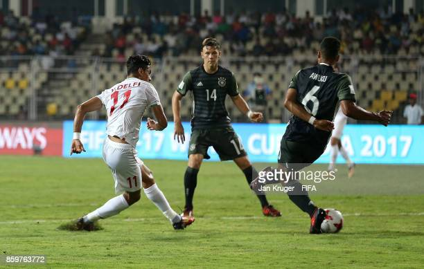 Younes Delfi of Iran scores the opening goal during the FIFA U17 World Cup India 2017 group C match between Iran and Germany at Pandit Jawaharlal...