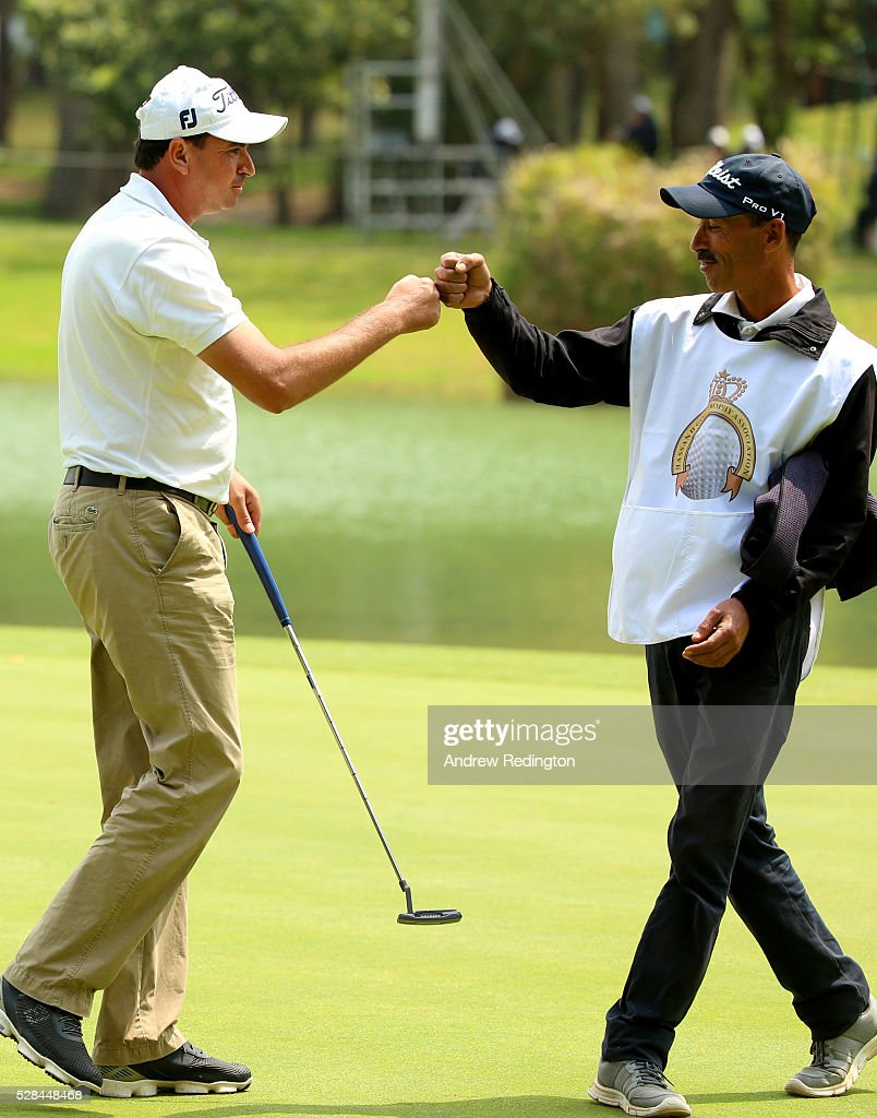 Younes El Hassani of Morocco celebrates with his caddie after a birdie putt on the 9th during the first round of the Trophee Hassan II at Royal Golf Dar Es Salam on May 5, 2016 in Rabat, Morocco.