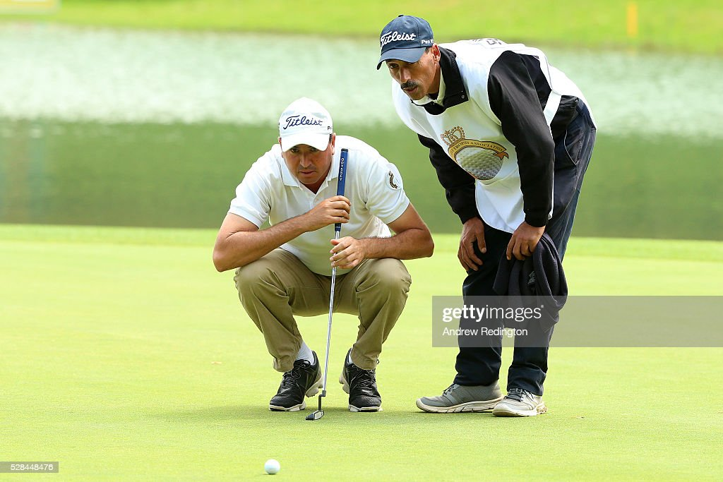 Younes El Hassani of Morocco lines up a putt with his caddie on the 9th during the first round of the Trophee Hassan II at Royal Golf Dar Es Salam on May 5, 2016 in Rabat, Morocco.
