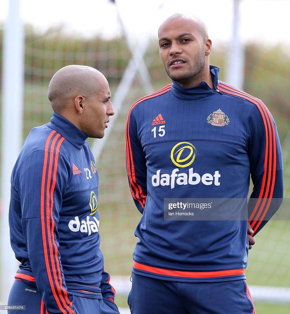Younes Kaboul (R) chats with Wahbi Khazri during a Sunderland training session at The Academy of Light on May 5, 2016 in Sunderland, England.