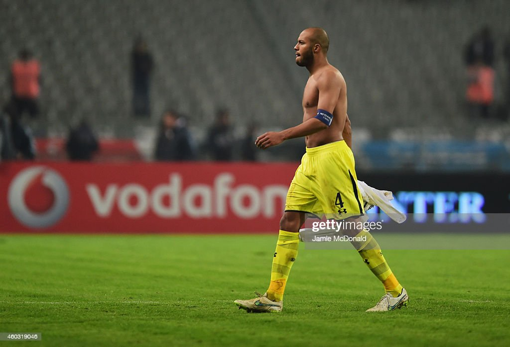 Younes Kaboul of Spurs looks dejected in defeat after the UEFA Europa League Group C match between Besiktas JK and Tottenham Hotspur FC at Ataturk Olympic Stadium on December 11, 2014 in Istanbul, Turkey.