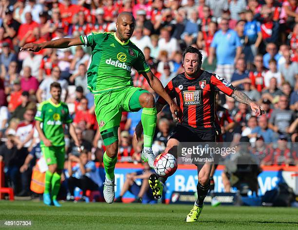 Younes Kaboul of Sunderland and Lee Tomlin of Bournemouth compete for the ball during the Barclays Premier League match between AFC Bournemouth and...