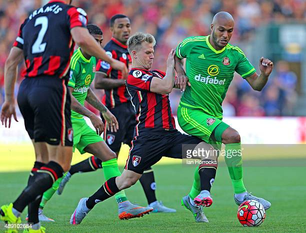 Younes Kaboul of Sunderland defends against Matt Richie of Bournemouth during the Barclays Premier League match between Bournemouth and Sunderland at...