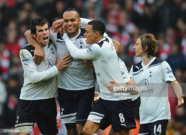 Younes Kaboul of Tottenham celebrates with team mates Gareth Bale and Jermaine Jenas after scoring the winner during the Barclays Premier League...