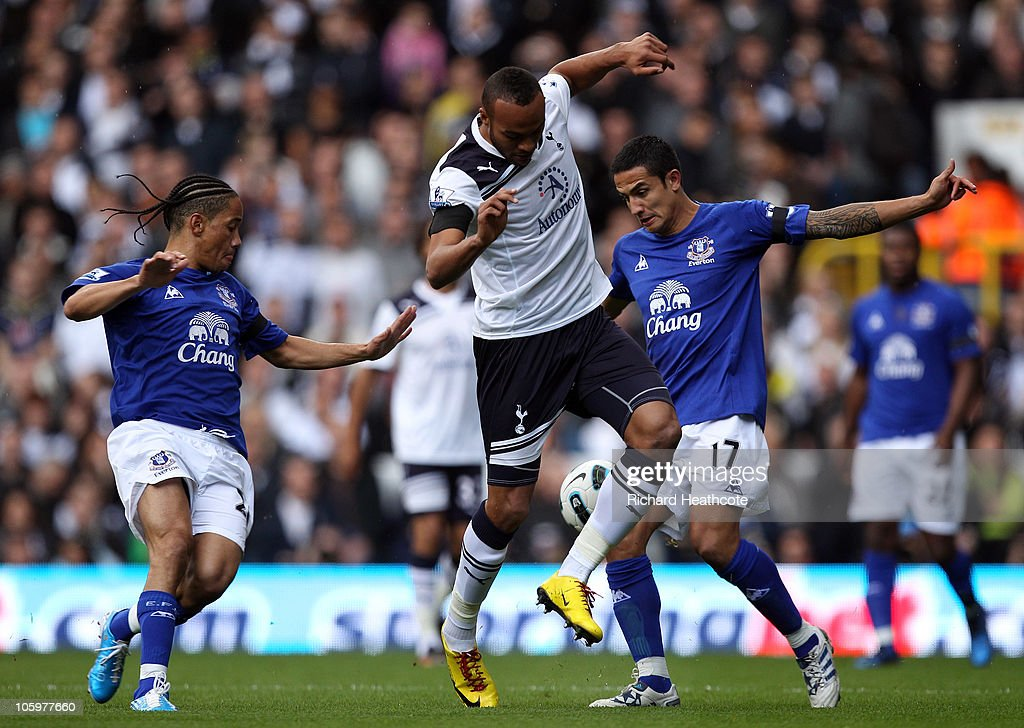 <a gi-track='captionPersonalityLinkClicked' href=/galleries/search?phrase=Younes+Kaboul&family=editorial&specificpeople=685970 ng-click='$event.stopPropagation()'>Younes Kaboul</a> of Tottenham is tackled by <a gi-track='captionPersonalityLinkClicked' href=/galleries/search?phrase=Steven+Pienaar&family=editorial&specificpeople=787271 ng-click='$event.stopPropagation()'>Steven Pienaar</a> and <a gi-track='captionPersonalityLinkClicked' href=/galleries/search?phrase=Tim+Cahill+-+Soccer+Player&family=editorial&specificpeople=209085 ng-click='$event.stopPropagation()'>Tim Cahill</a> of Everton during the Barclays Premier League match between Tottenham Hotspur and Everton at White Hart Lane on October 23, 2010 in London, England.