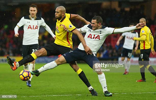 Younes Kaboul of Watford and Vincent Janssen of Tottenham Hotspur battle for the ball during the Premier League match between Watford and Tottenham...