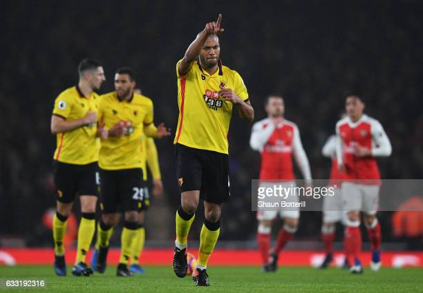 Younes Kaboul of Watford celebrates scoring the opening goal during the Premier League match between Arsenal and Watford at Emirates Stadium on...